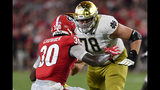Georgia linebacker Tae Crowder (30) moves near Notre Dame offensive lineman Tommy Kraemer (78) during the first half of an NCAA college football game, Saturday, Sept. 21, 2019, in Athens, Ga. (AP Photo/Mike Stewart)