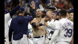 Tampa Bay Rays' Nate Lowe, center, celebrates after his walk-off, two-run home run off Boston Red Sox relief pitcher Josh Smith during the 11th inning of a baseball game, Saturday, Sept. 21, 2019, in St. Petersburg, Fla. (AP Photo/Chris O'Meara)