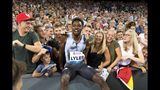 Noah Lyles from the USA reacts together with fans after winning the men's 100m race, during the Weltklasse IAAF Diamond League international athletics meeting in the stadium Letzigrund in Zurich, Switzerland, Thursday, August 29, 2019. (Jean-Christophe Bott/Keystone via AP)
