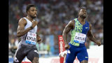 Noah Lyles from the USA and Justin Gatlin from the USA, from left, compete in the men's 100m race, during the Weltklasse IAAF Diamond League international athletics meeting in the stadium Letzigrund in Zurich, Switzerland, Thursday, August 29, 2019. (Jean-Christophe Bott/Keystone via AP)