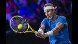 Team Europe's Rafael Nadal returns a ball to Team world's Milos Raonic during their singles match at the Laver Cup tennis event, in Geneva, Switzerland, Saturday, Sept. 21, 2019. (Martial Trezzini/Keystone via AP)