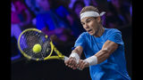 Team Europe's Rafael Nadal returns a ball to Team world's Milos Raonic during their singles match at the Laver Cup tennis event, in Geneva, Switzerland, Saturday, Sept. 21, 2019. (Martial Trezzini/Keystone via AP)