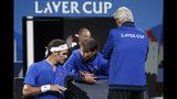Team Europe's Rafael Nadal, center, speaks to Team Europe's Roger Federer, left, next to Team Europe's Captain, Bjorn Borg during a match against Team World's Nick Kyrgios at the Laver Cup tennis event in Geneva, Switzerland, Saturday, Sept. 21, 2019. (Salvatore Di Nolfi/Keystone via AP)