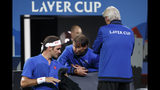 Team Europe's Rafael Nadal, center, speaks to Team Europe's Roger Federer, left, next to Team Europe's Captain, Bjorn Borg during a match against Team World's Nick Kyrgios at the Laver Cup tennis event in Geneva, Switzerland, Saturday, Sept. 21, 2019. (Salvatore Di Nolfi/Keystone via AP)