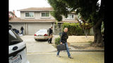 FILE - In this July, 29, 2019, file photo, police officers carry evidence bags from the family home of Gilroy Garlic Festival gunman Santino William Legan, in Gilroy, Calif. In the days and weeks since three high-profile shootings took the lives of more than two dozen people in just a week's time, law enforcement authorities have reported seeing a spike in the number of tips they are receiving from concerned relatives, friends and co-workers of people who appear bent on carrying out the next mass shooting. (AP Photo/Noah Berger, File)