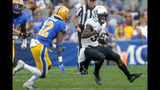 Central Florida running back Greg McCrae (30) tries to evade Pittsburgh defensive back Paris Ford (12) on a ruin during the first half of an NCAA college football game, Saturday, Sept. 21, 2019, in Pittsburgh. (AP Photo/Keith Srakocic)