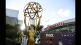 An Emmy statue stands outside the Microsoft Theater during Press Preview Day for Sunday's 71st Primetime Emmy Awards, Thursday, Sept. 19, 2019, in Los Angeles. (Photo by Chris Pizzello/Invision/AP)