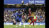 Liverpool goalkeeper Adrian grabs the ball during the British premier League soccer match between Chelsea and Liverpool, at the Stamford Bridge Stadium, London, Sunday, Sept. 22, 2019. (AP Photo/Matt Dunham)