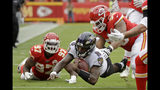 Baltimore Ravens quarterback Lamar Jackson (8) is tackled by Kansas City Chiefs defensive end Alex Okafor (97) and defensive tackle Xavier Williams, right, during the first half of an NFL football game in Kansas City, Mo., Sunday, Sept. 22, 2019. (AP Photo/Charlie Riedel)
