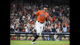 Houston Astros' George Springer rounds the bases after hitting a solo home run off Los Angeles Angels relief pitcher Jose Suarez during the fourth inning of a baseball game Sunday, Sept. 22, 2019, in Houston. it was Springer's third home run of the game. (AP Photo/Eric Christian Smith)