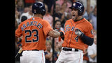 Houston Astros' George Springer, right, celebrates his two-run home run off Los Angeles Angels relief pitcher Jose Rodriguez with Michael Brantley during the second inning of a baseball game Sunday, Sept. 22, 2019, in Houston. (AP Photo/Eric Christian Smith)