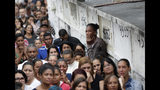 Relatives and friends of the late 8-year-old Ágatha Sales Felix attend her burial at a cemetery in Rio de Janeiro, Brazil, Sunday, Sept. 22, 2019. Félix was hit by a stray bullet Friday amid what police said was shootout with suspected criminals. However, residents say there was no shootout, and blame police. (AP Photo/Silvia Izquierdo)