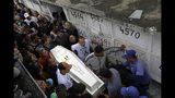 People carry the coffin of 8-year-old Ágatha Sales Felix, who was hit by a a stray bullet, at a cemetery in Rio de Janeiro, Brazil, Sunday, Sept. 22, 2019. Félix was hit by a stray bullet Friday amid what police said was shootout with suspected criminals. However, residents say there was no shootout, and blame police. (AP Photo/Silvia Izquierdo)