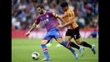 Crystal Palace's Luka Milivojevic, left, and Wolverhampton Wanderers' Pedro Neto battle for the ball during the English Premier League soccer match at Selhurst Park, London, Sunday Sept. 22, 2019. (Daniel Hambury/PA via AP)
