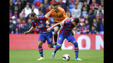 Wolverhampton Wanderers' Diogo Jota, center, battles for the ball with Crystal Palace's James McArthur. left, and Joel Ward during their English Premier League match at Selhurst Park, London, Sunday, Sept. 22, 2019. (Daniel Hambury/PA via AP)
