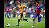 Wolverhampton Wanderers' Diogo Jota, left, and Crystal Palace's Joel Ward battle for the ball during their English Premier League match at Selhurst Park, London, Sunday, Sept. 22, 2019. (Daniel Hambury/PA via AP)