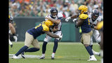 Denver Broncos quarterback Joe Flacco, center, is hit by Green Bay Packers outside linebacker Preston Smith, left, as Packers' linebacker Rashan Gary, right, watches during the first half of an NFL football game Sunday, Sept. 22, 2019, in Green Bay, Wis. (AP Photo/Matt Ludtke)