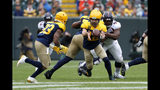 Green Bay Packers quarterback Aaron Rodgers, right, pitches the ball to running back Aaron Jones, left, during the first half of an NFL football game against the Denver Broncos Sunday, Sept. 22, 2019, in Green Bay, Wis. (AP Photo/Matt Ludtke)