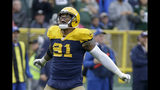 Green Bay Packers outside linebacker Preston Smith celebrates after the Denver Broncos turned over the ball on downs near the end of the second half of an NFL football game Sunday, Sept. 22, 2019, in Green Bay, Wis. (AP Photo/Mike Roemer)