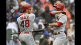 St. Louis Cardinals' Paul DeJong right, celebrates with teammate Harrison Bader (48) after hitting a solo home run during the third inning of a baseball game against the Chicago Cubs, Sunday, Sept. 22, 2019, in Chicago. (AP Photo/Paul Beaty)