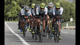Members of the Esteban Chaves Foundation cycling team train in Puente Piedra near Bogota, Colombia, Friday, Sept. 13, 2019. Although the foundation team's cyclists take mandatory doping tests, Colombia has 42 cyclists currently sanctioned or provisionally suspended. Only Costa Rica has more cyclists suspended by the sport's world governing body than Colombia. (AP Photo/Fernando Vergara)