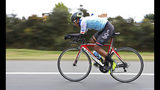 Jonathan Bustamante, of the Esteban Chaves Foundation cycling team, takes part in a time trial training session in Puente Piedra near in Bogota, Colombia, Friday, Sept. 13, 2019. In the weeks since Egan Bernal became the first Colombian to win the Tour de France, the country has been basking in attention focused on its reputation for churning out specialist climbers raised on thin mountain air and possessing the sort of superhuman stamina taught by poverty. (AP Photo/Fernando Vergara)