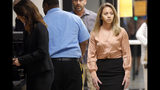 FILE - In this Sept. 13, 2019 file photo, fired Dallas police Officer Amber Guyger, right, arrives for jury selection in her murder trial at the Frank Crowley Courthouse in downtown Dallas. The murder trial for a Guyger who shot and killed Botham Jean, an unarmed black man in his Dallas apartment is set for opening arguments Monday Sept. 23, 2019. (Tom Fox/The Dallas Morning News via AP File)