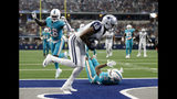Dallas Cowboys wide receiver Amari Cooper (19) catches a pass for a touchdown in front of Miami Dolphins' Xavien Howard (25) and Bobby McCain (28) in the second half of an NFL football game in Arlington, Texas, Sunday, Sept. 22, 2019. (AP Photo/Ron Jenkins)