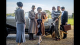 """This image released by Focus Features shows Elizabeth McGovern, from left, Harry Hadden-Paton, Laura Carmichael, Hugh Bonneville and Michael Fox, right, in a scene from the film """"Downton Abbey."""" (Jaap Buitendijk/Focus Features via AP)"""