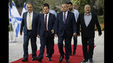 Members of the Joint List, from left to right, Osama Saadi, Ayman Odeh, Ahmad Tibi and Mansour Abbas arrive for a consulting meeting with Israeli President Reuven Rivlin, in Jerusalem, Sunday, Sept. 22, 2019. Rivlin began two days of crucial talks Sunday with party leaders before selecting his candidate for prime minister, after a deadlocked repeat election was set to make forming any new government a daunting task. (Menahem Kahana/Pool via AP)