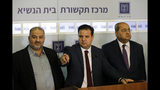 Members of the Joint List Ayman Odeh, center, speaks to the press in the presence of Ahmad Tibi, right, and Mansour Abbas following their consulting meeting with Israeli President Reuven Rivlin, in Jerusalem, Sunday, Sept. 22, 2019. Rivlin began two days of crucial talks Sunday with party leaders before selecting his candidate for prime minister, after a deadlocked repeat election was set to make forming any new government a daunting task. (Menahem Kahana/Pool via AP)
