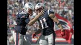 New England Patriots quarterback Tom Brady, left, celebrates his touchdown pass to Julian Edelman, right, in the first half of an NFL football game against the New York Jets, Sunday, Sept. 22, 2019, in Foxborough, Mass. (AP Photo/Elise Amendola)