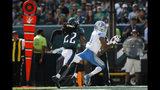 Marvin Jones, de los Lions de Detroit, atrapa un pase de touchdown frente a Sidney Jones, de los Eagles de Filadelfia, el domingo 22 de septiembre de 2019 (AP Foto/Matt Rourke)