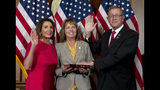 FILE - In this Jan. 3, 2019, file photo House Speaker Nancy Pelosi of Calif., administers the House oath of office to Rep. Paul Cook, R-Calif., during ceremonial swearing-in on Capitol Hill in Washington. Cook served 26 years as a Marine, earning two Purple Heart medals for combat wounds suffered in Vietnam. But amid his seventh year in Congress, the aching and discouraged California Republican has decided he's endured enough (AP Photo/Jose Luis Magana, File)