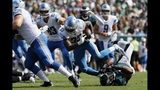 Detroit Lions' Kerryon Johnson (33) rushes over Philadelphia Eagles' Brandon Graham (55) during the first half of an NFL football game Sunday, Sept. 22, 2019, in Philadelphia. (AP Photo/Michael Perez)