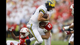CORRECTS SCORE TO 35-14-Wisconsin linebacker Jack Sanborn (57) tackles Michigan quarterback Dylan McCaffrey during the second half of an NCAA college football game Saturday, Sept. 21, 2019, in Madison, Wis. Wisconsin won 35-14. (AP Photo/Andy Manis)
