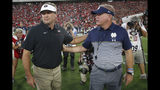 Georgia head coach Kirby Smart, left, speaks with Notre Dame head coach Brian Kelly before the first half of an NCAA college football game, Saturday, Sept. 21, 2019, in Athens, Ga. (AP Photo/John Bazemore)