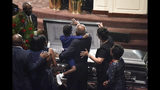 House Majority Whip Jim Clyburn and one of his granddaughters close the casket of his wife, Emily, during a funeral service on Sunday, Sept. 22, 2019, in West Columbia, S.C. (AP Photo/Meg Kinnard)