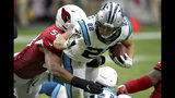 Carolina Panthers running back Christian McCaffrey (22) is hit by Arizona Cardinals middle linebacker Jordan Hicks (58) during the second half of an NFL football game, Sunday, Sept. 22, 2019, in Glendale, Ariz. (AP Photo/Ross D. Franklin)