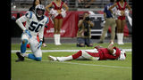 Arizona Cardinals quarterback Kyler Murray lies on the field after being sacked by Carolina Panthers linebacker Christian Miller (50) during the second half of an NFL football game, Sunday, Sept. 22, 2019, in Glendale, Ariz. (AP Photo/Rick Scuteri)