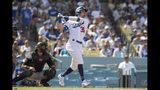 Cody Bellinger de los Dodgers de Los Angeles conecta un grand slam ante los Rockies de Colorado, el domingo 22 de septiembre de 2019. (AP Foto/Sam Gangwer )