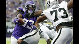Minnesota Vikings running back Dalvin Cook (33) scores on a 1-yard touchdown run ahead of Oakland Raiders defensive tackle Maurice Hurst (73) during the first half of an NFL football game, Sunday, Sept. 22, 2019, in Minneapolis. (AP Photo/Bruce Kluckhohn)