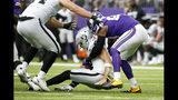 Minnesota Vikings defensive end Everson Griffen, right, sacks Oakland Raiders quarterback Derek Carr during the first half of an NFL football game, Sunday, Sept. 22, 2019, in Minneapolis. (AP Photo/Bruce Kluckhohn)
