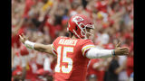 Kansas City Chiefs quarterback Patrick Mahomes (15) reacts after his touchdown pass to wide receiver Demarcus Robinson during the first half of an NFL football game against the Baltimore Ravens in Kansas City, Mo., Sunday, Sept. 22, 2019. (AP Photo/Charlie Riedel)