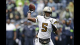 New Orleans Saints quarterback Teddy Bridgewater readies a throw against the Seattle Seahawks during the second half of an NFL football game, Sunday, Sept. 22, 2019, in Seattle. (AP Photo/Scott Eklund)