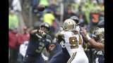 Seattle Seahawks quarterback Russell Wilson (3) throws against the New Orleans Saints during the first half of an NFL football game Sunday, Sept. 22, 2019, in Seattle. (AP Photo/Scott Eklund)