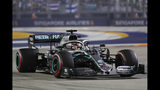 Mercedes driver Lewis Hamilton of Britain steers his car during the Singapore Formula One Grand Prix, at the Marina Bay City Circuit in Singapore, Sunday, Sept. 22, 2019. (AP Photo/Vincent Thian)