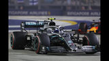 Mercedes driver Valtteri Bottas of Finland steers his car during the Singapore Formula One Grand Prix, at the Marina Bay City Circuit in Singapore, Sunday, Sept. 22, 2019. (AP Photo/Vincent Thian)