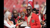 Former San Francisco 49ers wide receiver Terrell Owens is honored during a ceremony as he is inducted into the team's Hall of Fame during halftime of an NFL football game between the 49ers and the Pittsburgh Steelers in Santa Clara, Calif., Sunday, Sept. 22, 2019. (AP Photo/Tony Avelar)