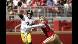 Pittsburgh Steelers quarterback Mason Rudolph (2) passes as he is pressured by San Francisco 49ers defensive end Arik Armstead during the second half of an NFL football game in Santa Clara, Calif., Sunday, Sept. 22, 2019. (AP Photo/Ben Margot)